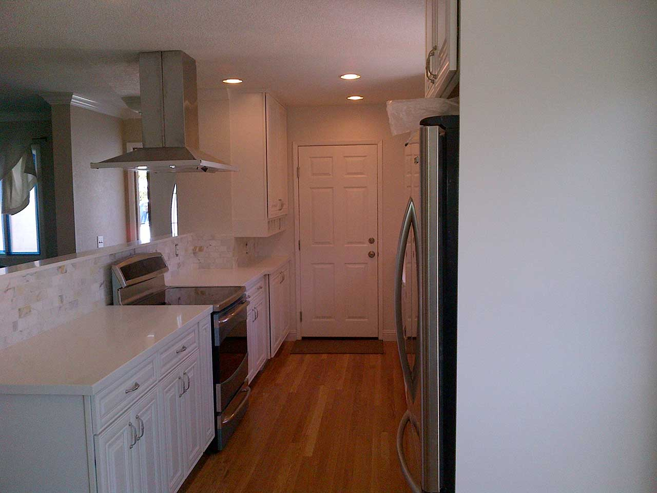 HOWE-kitchen-with-white-cabs-and-new-wood-floor-#2-1280x960